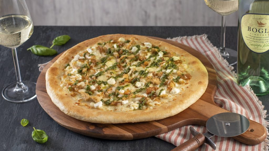 Chicken pesto pizza with caramelized onions