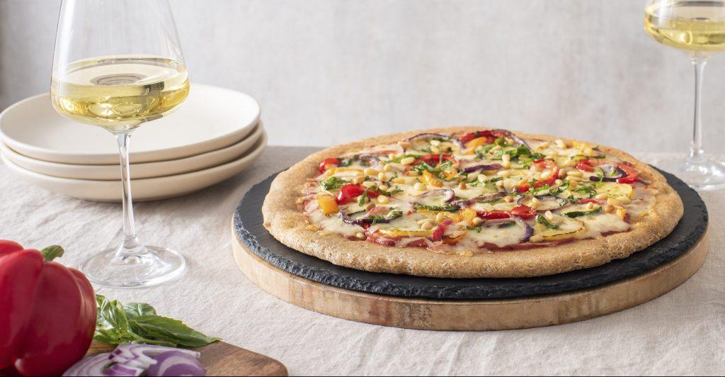 Vegan rainbow pizza with cornmeal crust